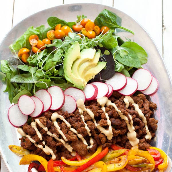 With bell peppers, fresh greens, avocado, and beef spiced up with homemade taco seasoning. It's also gluten-free and dairy-free, and comes with a vegan option too.Recipe here.