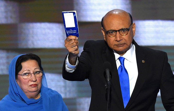 Khizr Khan offers his personal copy of the US Constitution to Donald Trump while addressing delegates on the fourth and final day of the Democratic National Convention. Khan's son, Humayun S. M. Khan was a University of Virginia graduate and enlisted in the US Army. He was one of 14 American Muslims who died serving the United States in the ten years after the September 11, 2001 terrorist attacks.