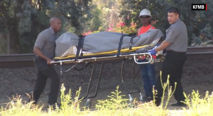 Authorities transport the body of the first victim in a string of homeless attacks in San Diego