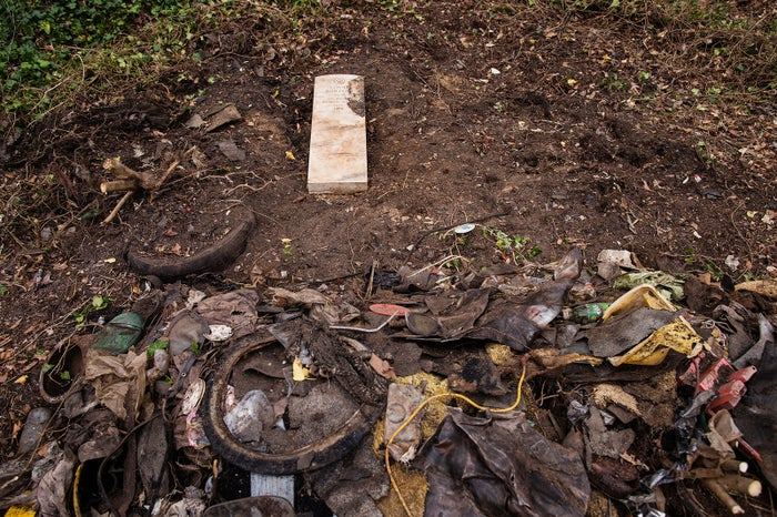 The headstone of US Army veteran Louis Burton found under a pile of illegally dumped trash, March 19, 2016.