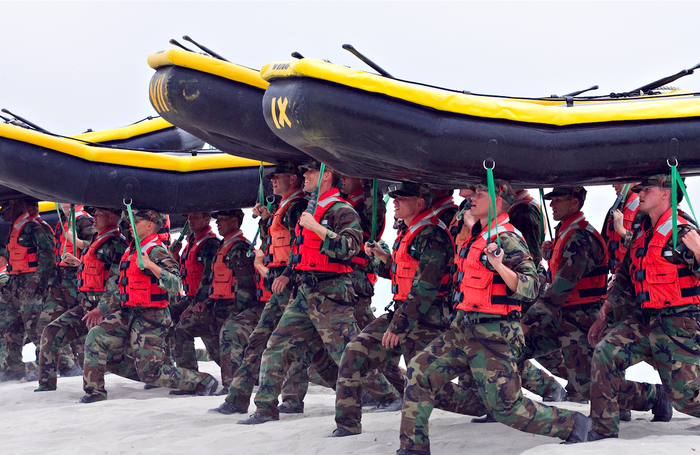 Navy SEAL trainees carry inflatable boats during at the Naval Amphibious Base Coronado in 2009.