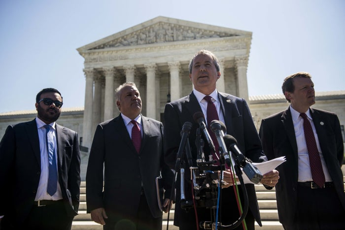Texas Attorney General Ken Paxton speaks to reporters at a news conference outside the Supreme Court on June 9, 2016.