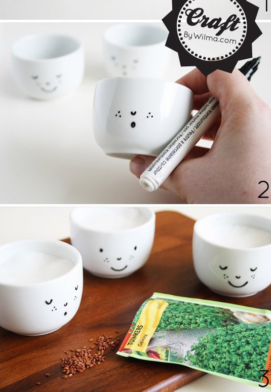 Draw simple little faces on teacups using a ceramic marker.