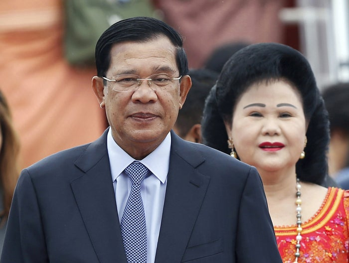 Cambodia's Prime Minister Hun Sen and his wife Bun Rany arrive for the 27th Association of Southeast Asian Nations (ASEAN) summit