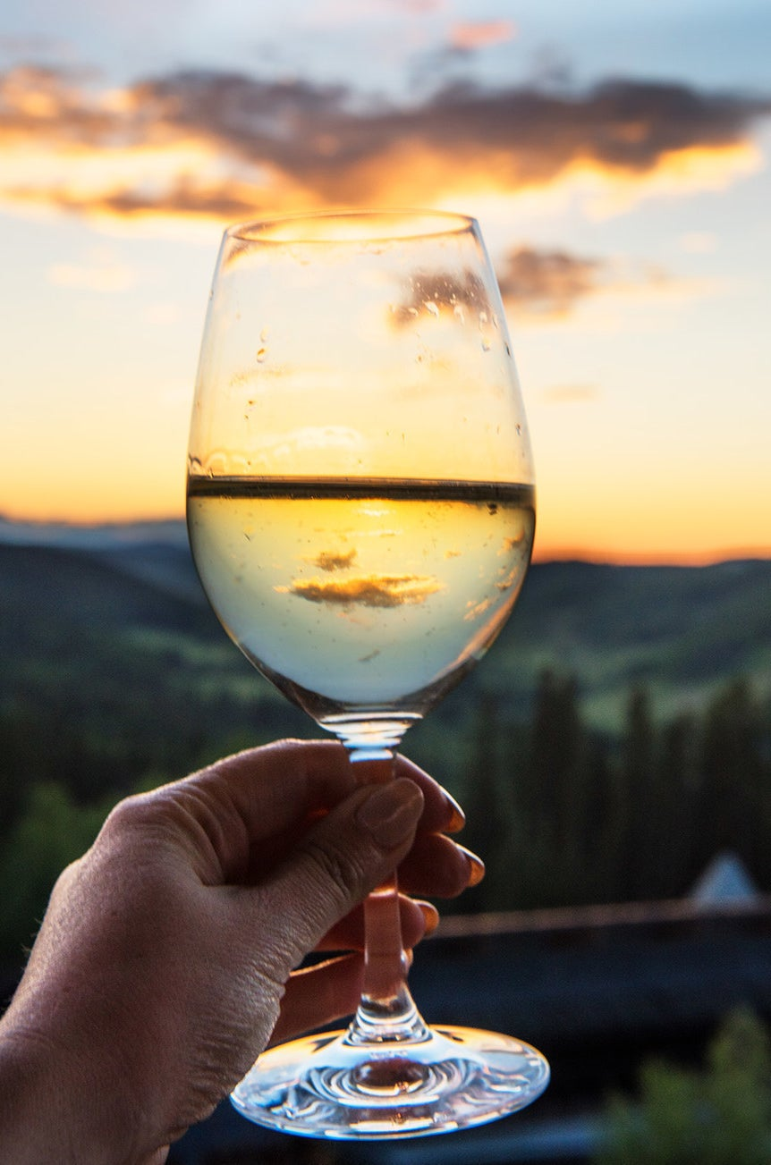 A treelined sunset through a glass of prosecco from the observatory tower.