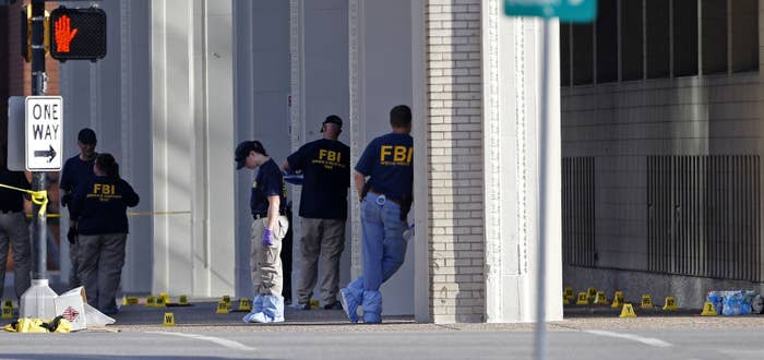An FBI evidence response team works at the scene of the police shootings in Dallas.