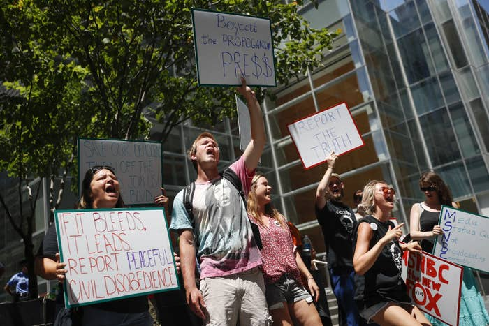 Demonstrators protest outside the Comcast Center in Philadelphia during the Democratic National Convention.