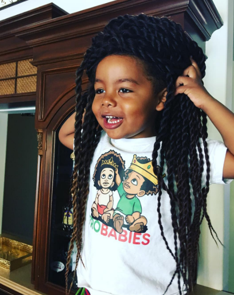 """She also captioned the image: """"Lol of course Sebastian had to be a spooky zombie in Mommy's wig today 😂 and he's loving his @frobabies T-shirt too 😍😍😍"""""""