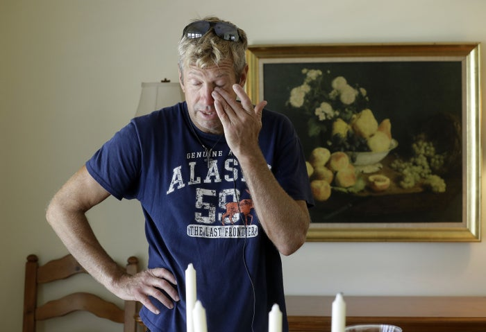 Steve Knowlton wipes his eyes as he talks about his mother Mary Knowlton during an interview Wednesday.