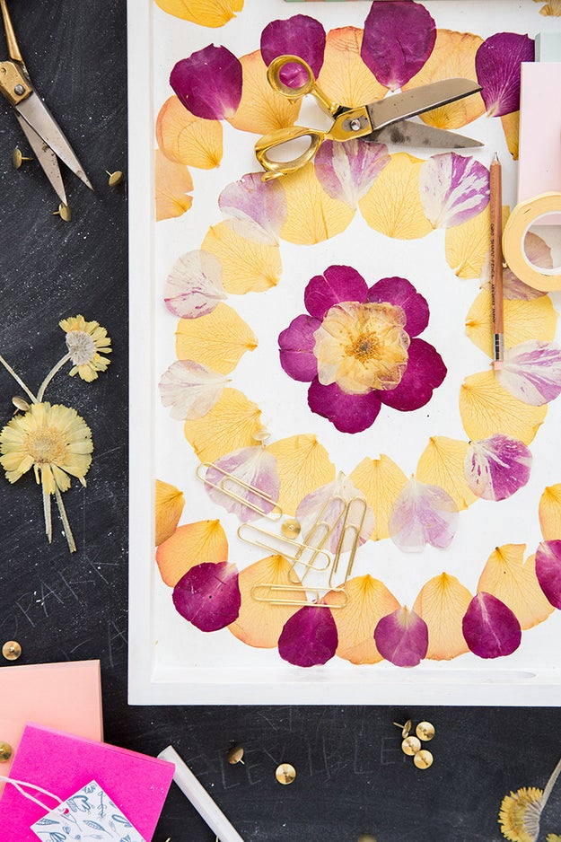 Decorate a tray with beautiful pressed flowers.