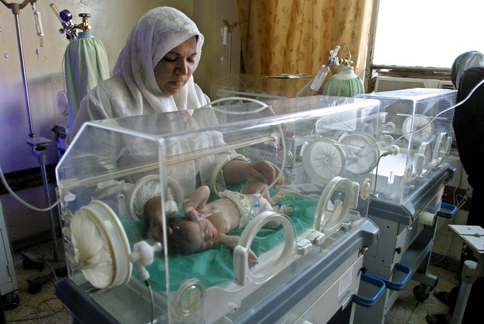 File photo of an Iraqi nurse tending a baby at the hospital in 2004.