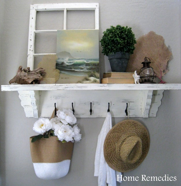 If you're not blessed with a built-in mudroom, pick an area to set a bench and hang up a shelf and a few hooks.
