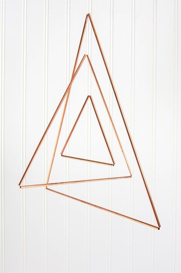 Form a geometric mobile using thin copper tubing.