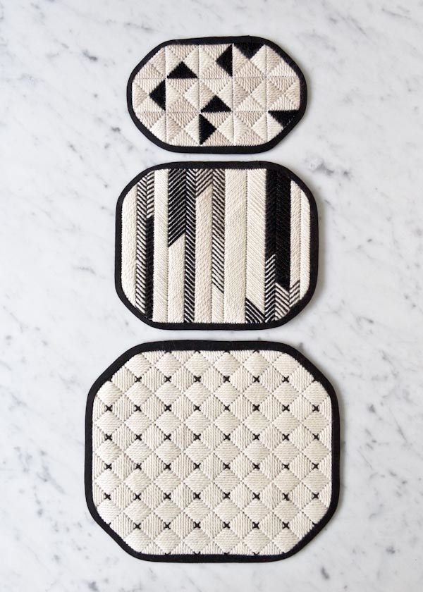 Needlepoint a trio of graphic trivets for your kitchen.