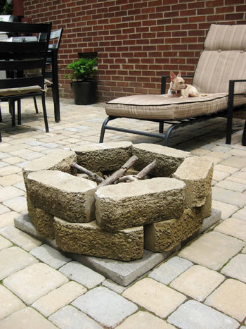Build a simple fire pit for less than $40 using heat-resistant stones.