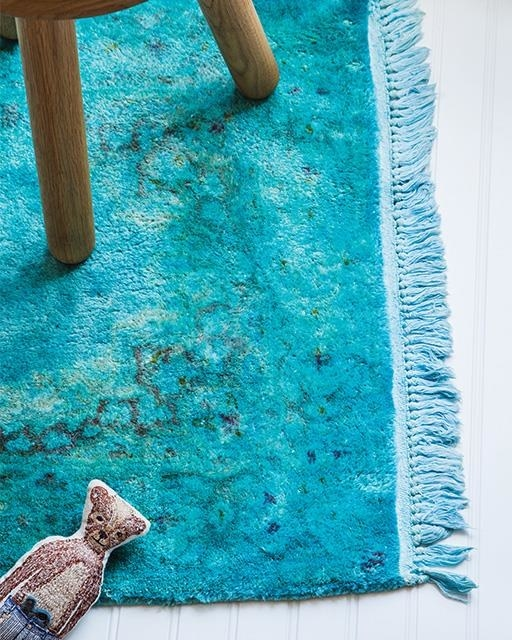 """Overdye"" a drab rug you've had for years to give it a trendy makeover."