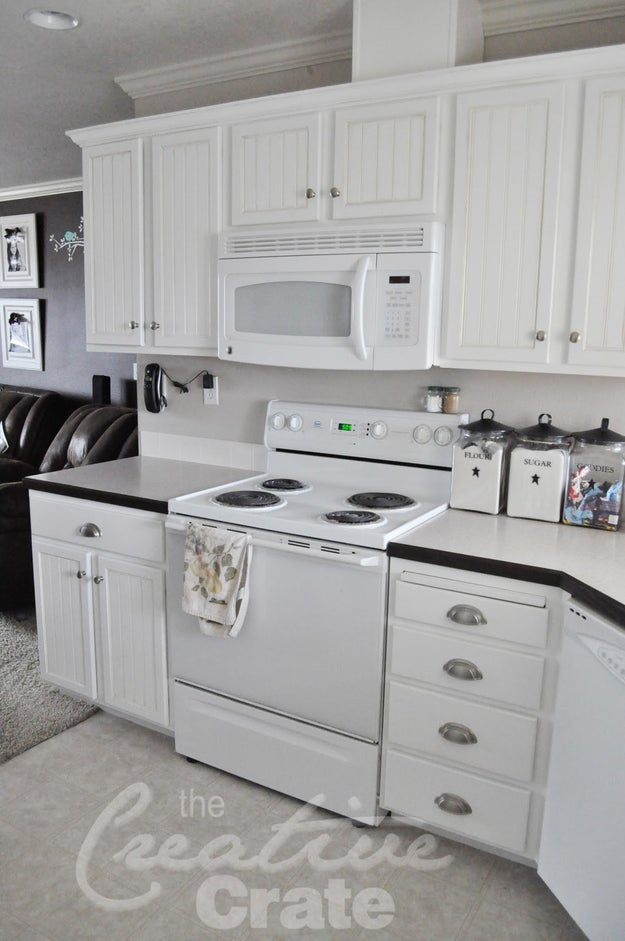 Install bead board or bead board wallpaper to upgrade the kitchen cabinets you already have.