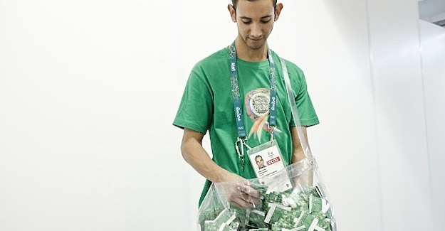 This Guy's Job Is To Carry A Bag Of Condoms At The Olympics
