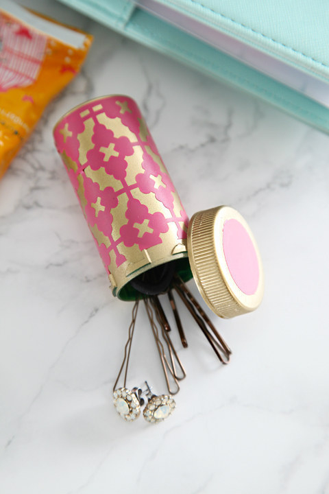 Dress up an old pill bottle to keep your bobby pins close at hand.