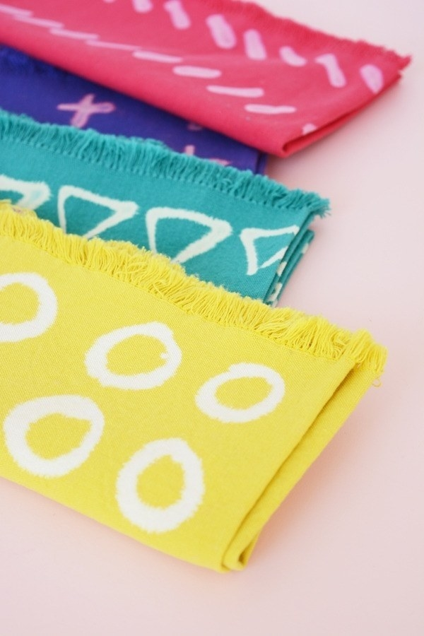 Customize colorful napkins by doodling on them with bleach pens, which you can get at the grocery store.