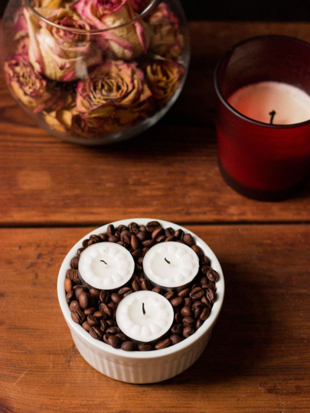 Fill an empty vase with coffee beans and candles for affordable aromatherapy.