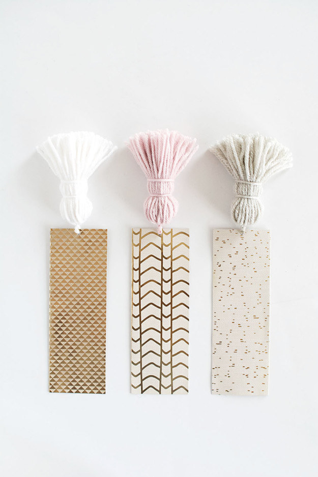 Slice up strips of pretty cardstock and add tassels to them for easy-to-grab bookmarks.