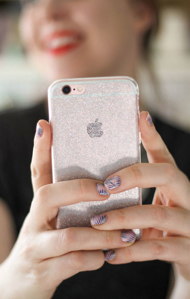 Stick a piece of adhesive glitter vinyl to a clear phone case to make it less boring.