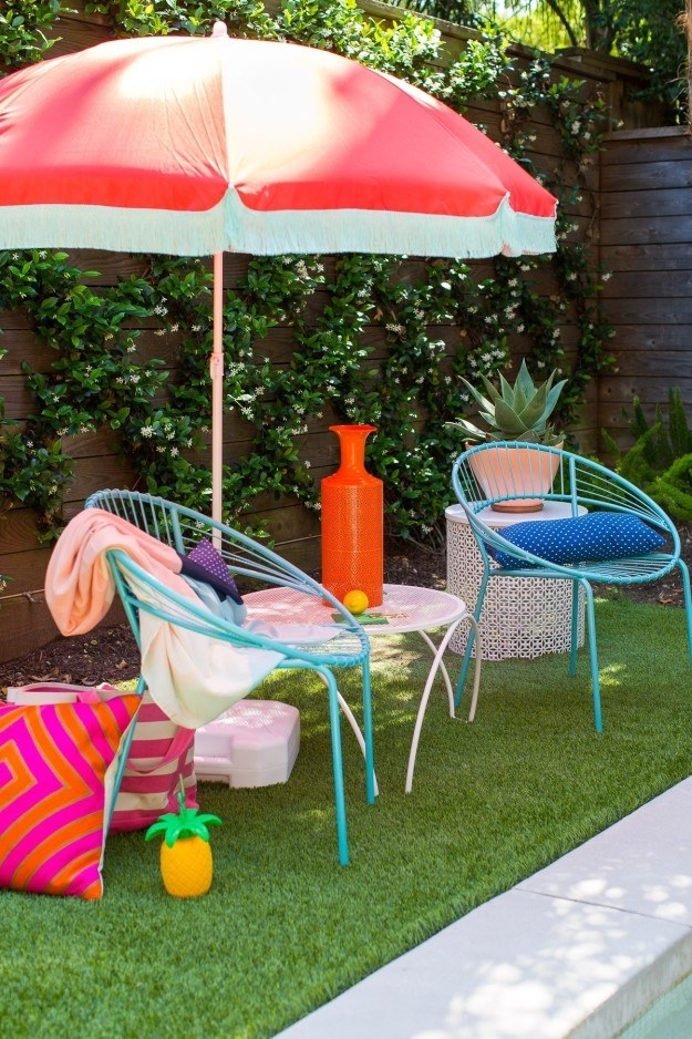 Hot glue a few yards of fringe to your patio umbrella to give it a vintage vibe.