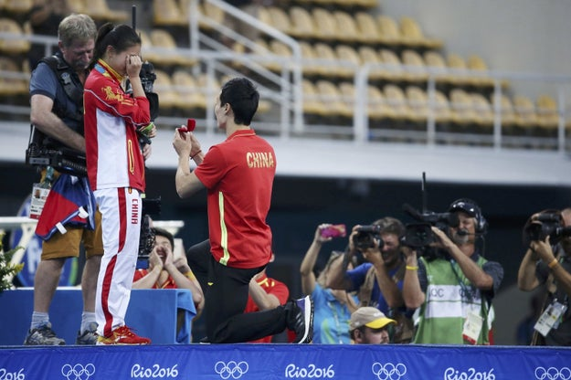 He's boyfriend, fellow Chinese diver Qin Kai, came up on stage and got down on one knee.