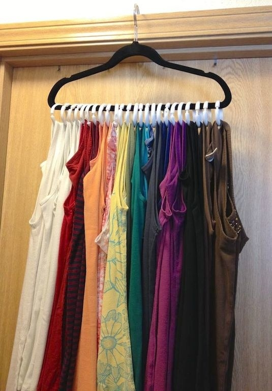 Use shower curtain rings and a hanger to hang your 2 million tank tops.