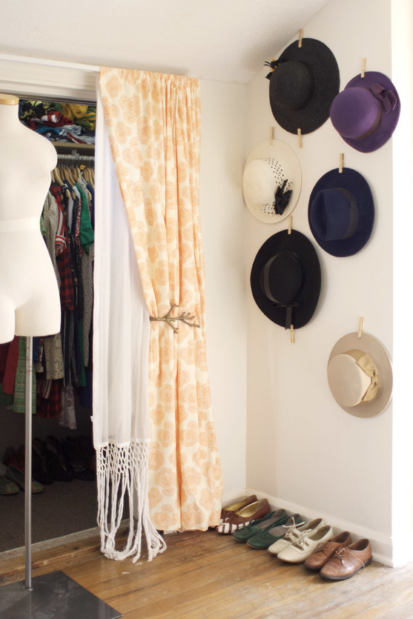 Clip the hats you wear most to the wall, using removable adhesive strips and clothespins.