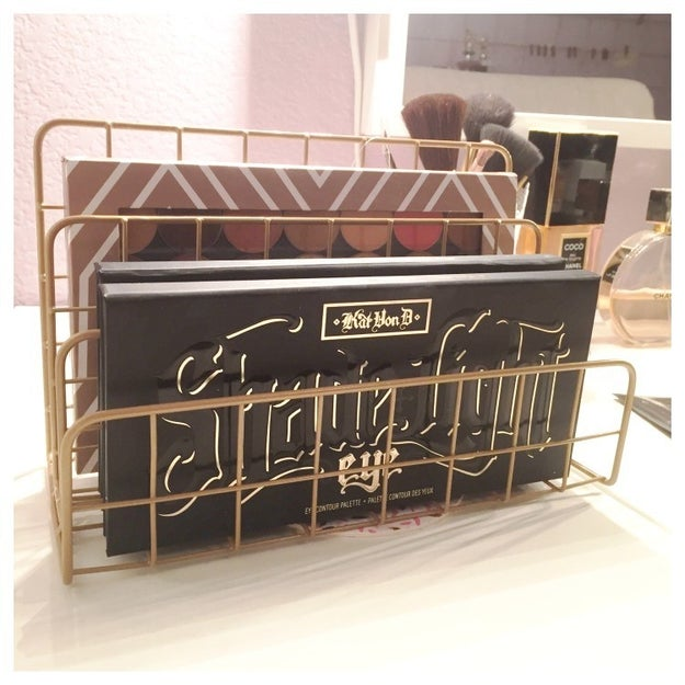 Stack your makeup palettes in an easy-to-find row using a dollar store letter organizer.