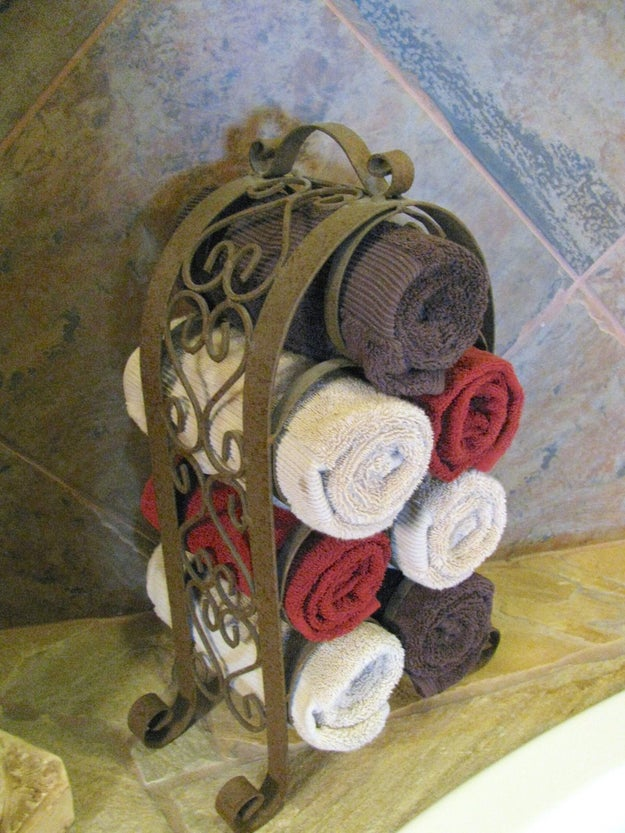 Roll your dish towels or dish rags up and store them in a wine rack on your countertop to make them easy to grab.