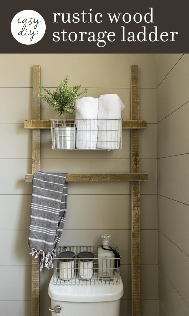 Nail four pieces of wood together to make an above-toilet storage ladder that doubles as storage and another towel bar.