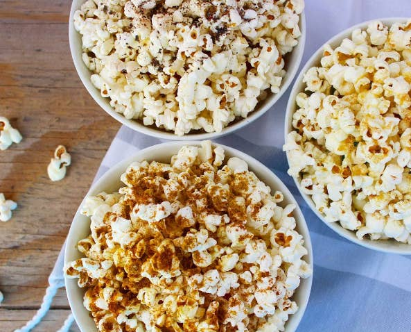 """Popcorn is a satisfying and nutritious snack that can be whipped up in a matter of minutes. For this recipe, you can either go with a curry paprika, garlic parm, or spicy oregano spice blend."" Get the recipes here.—Wendy Lopez, MS, RD, and Jessica Jones, MS, RD of Food Heaven Made Easy"