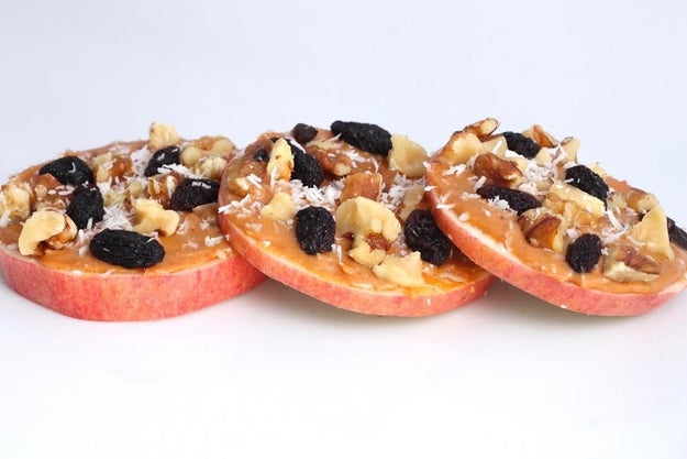 Apple Rounds with Peanut Butter, Walnuts, Raisins, and Coconut