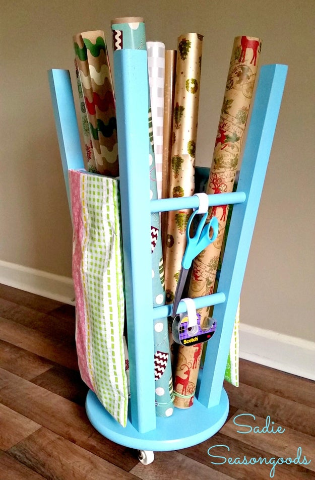 Flip an old stool over, screw in a few casters, and use it as a portable gift wrap station.