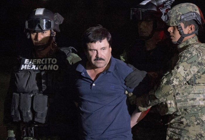"Mexican drug lord Joaquin ""El Chapo"" Guzman is escorted by army soldiers on Jan. 8, 2016."