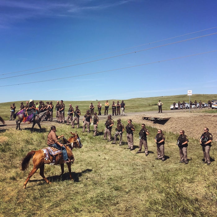 Riders from the Standing Rock, Rosebud, and Lower Brule Lakota reservations came together on horseback to push back a police line that had formed between a group of protesters and the entrance to the Dakota Access Pipeline construction site.