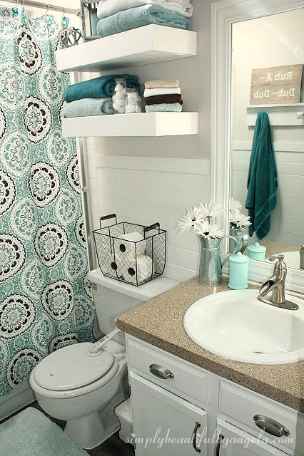 Top your toilet with a high-sided basket to use for extra storage — whether it's toilet paper, towels, soap, or something else.