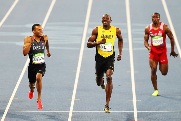 Andre de Grasse and Usain Bolt honestly look like they're having the time of their lives in a neighbourhood fun run, not sprinting their little hearts out in an Olympic semi-final.