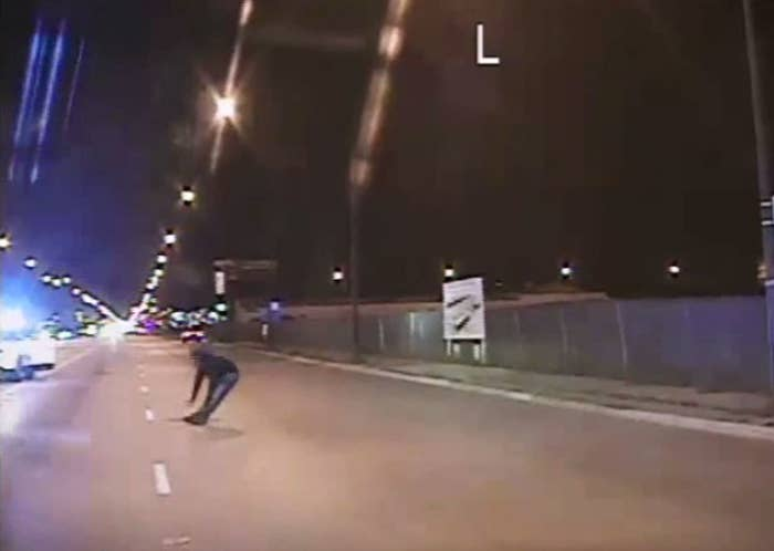 In this still image taken from a police vehicle dash camera relased by the Chicago Police Department on November 24, 2015, Laquan McDonald falls to the ground after being shot by Chicago Police officer Jason Van Dyke.