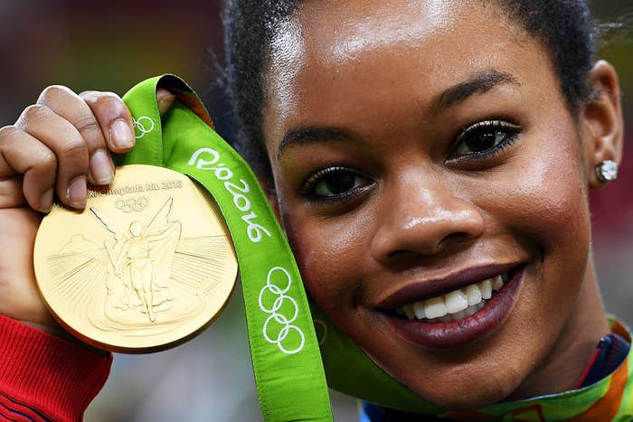 """Author: Demetria Lucas D'OyleyOutlet: The RootIf you follow journalist Demetria Lucas D'Oyley, then you know she's never one to hold back. In an essay, """"Gabby Douglas Only Has 1 Job—and It Isn't to Fix Her Hair to Please You,"""" for The Root, she addresses the ongoing criticism Olympic gold medalist Gabrielle Douglas has been receiving for her hair. D'Oyley calls the focus of Douglas' hair """"dumb shit,"""" and points out that while her edges may not be laid on the uneven bars, they most definitely are """"On the covers of Essence and People and Time and Teen Vogue"""" and on the front of the Corn Flakes box! Read where else the gymnast champ's hair is laid here."""