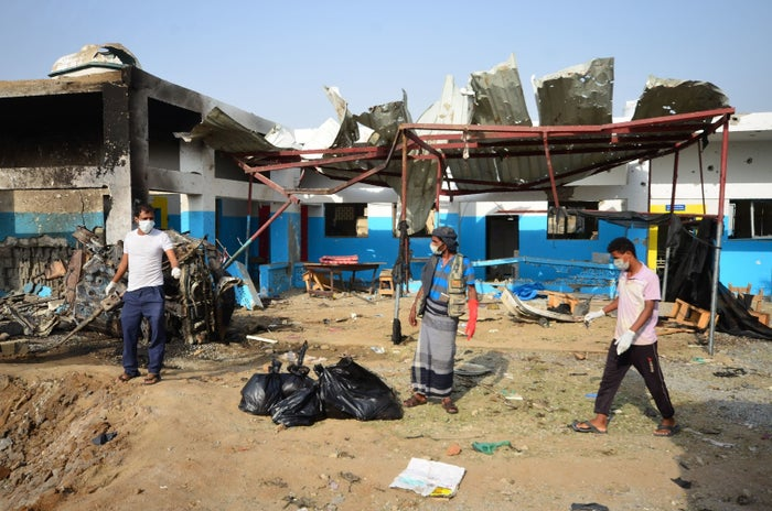 Yemeni workers clean up an MSF hospital bombed in August.