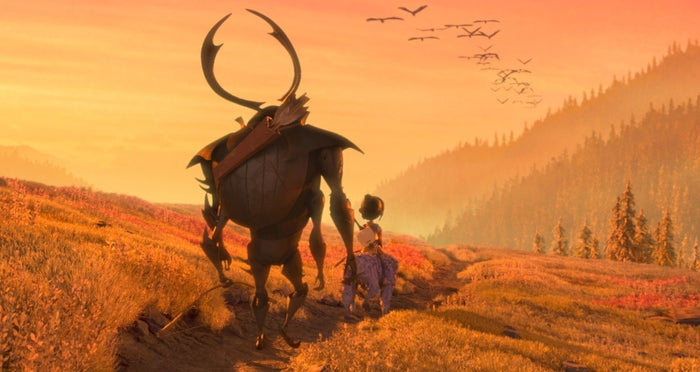 Beetle (voiced by Matthew McConaughey) with Monkey and Kubo in Kubo and the Two Strings.