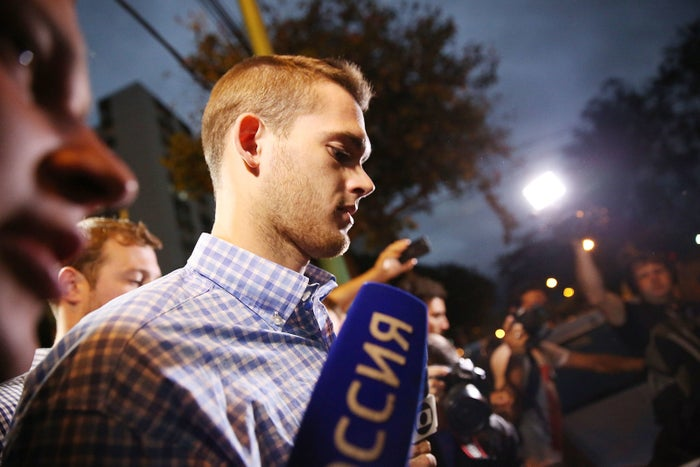 Gunnar Bentz leave a police station after being questioned Thursday in Rio de Janeiro.