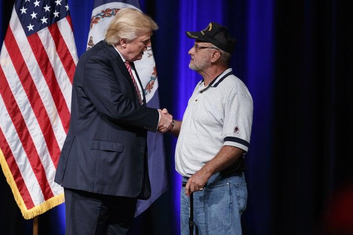 Trump shakes hands with Dorfman.