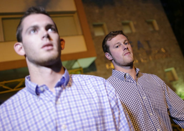 Bentz, left, and Conger leave a police station after being questioned in Rio on Thursday.