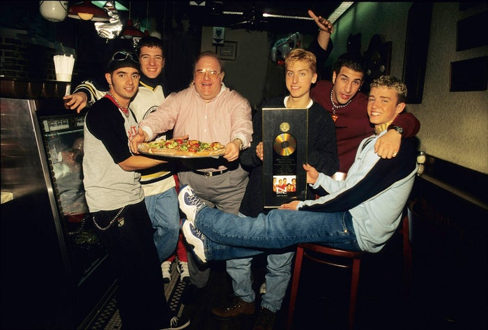 Lou Pearlman poses with NSYNC in 1996.