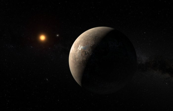 Artist's impression of Proxima b with Proxima Centauri in the background.